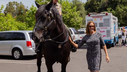 Asm. Irwin with officer on horseback